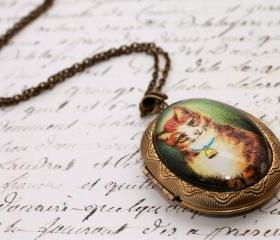 Cat photo locket, ca..